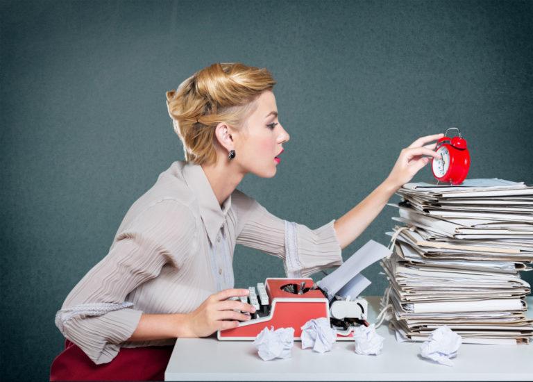 woman writing on the typewriter