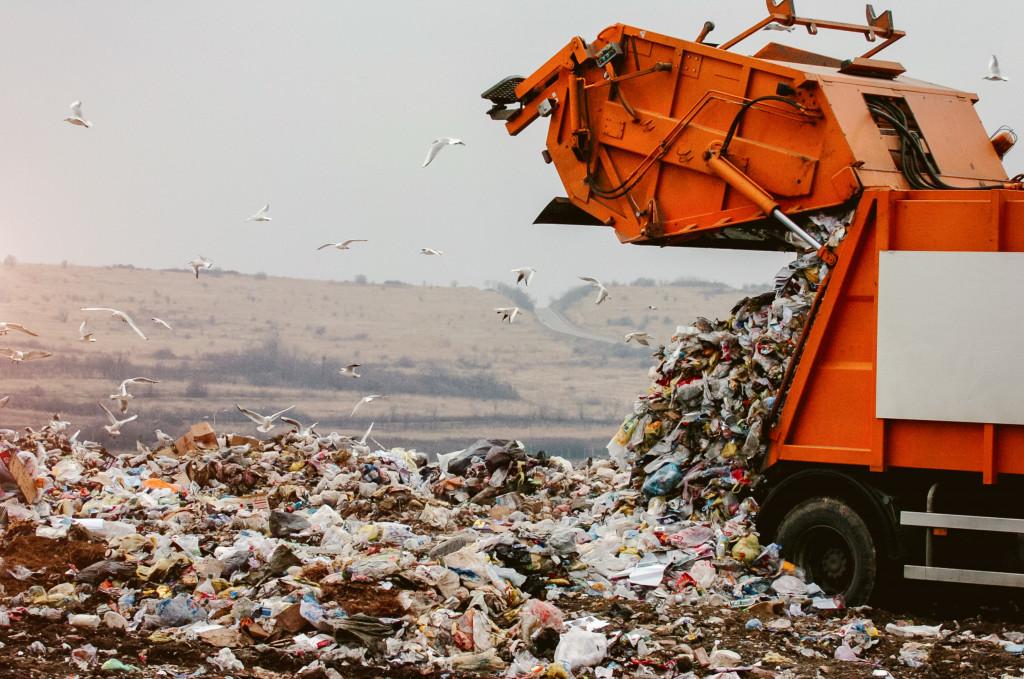 dumping trash in a lanfill