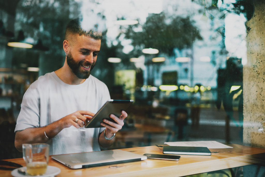 man in a cafe with computers